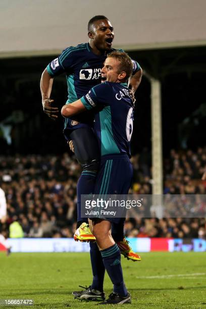 Stephane Sessegnon of Sunderland celebrates with teammate Lee Cattermole after scoring his team's third goal during the Barclays Premier League match...
