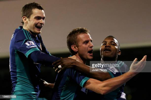 Stephane Sessegnon of Sunderland celebrates with teammates Adam Johnson and Lee Cattermole after scoring his team's third goal during the Barclays...