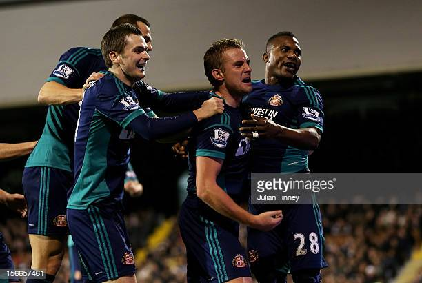 Stephane Sessegnon of Sunderland celebrates with teammates after scoring his team's third goal during the Barclays Premier League match between...