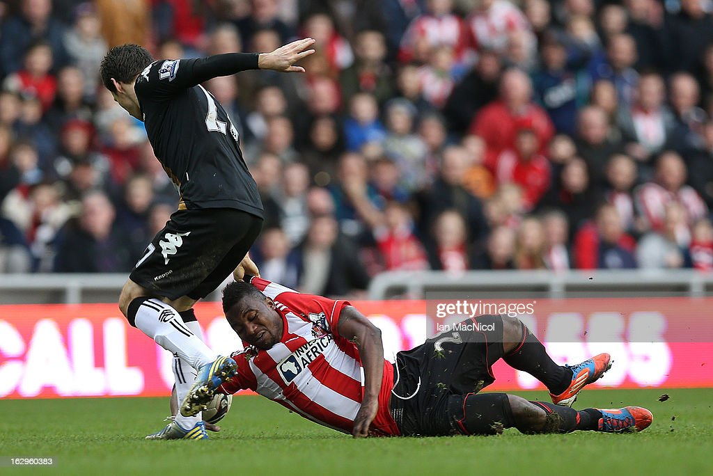 Stephane Sessegnon of Sunderland competes with Sasha Riether of Fulham during the Barclays Premier League match between Sunderland and Fulham at the Stadium of Light on March 02, 2013 in Sunderland, England.