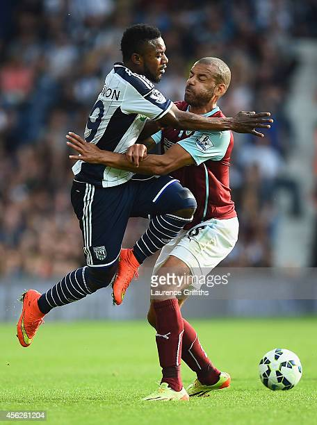 Stephane Sessegnon of West Brom collides with Steven Reid of Burnley during the Barclays Premier League match between West Bromwich Albion and...