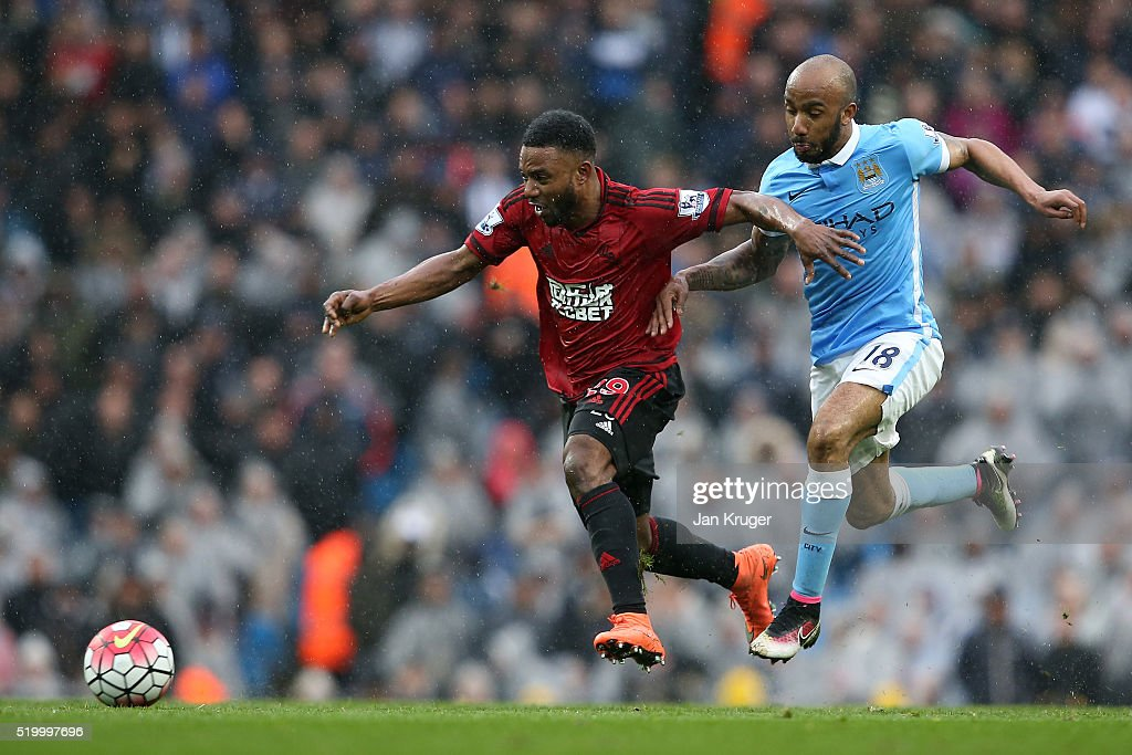 Stephane Sessegnon of West Bromwich Albion and Fabian Delph of Manchester City compete for the ball during the Barclays Premier League match between Manchester City and West Bromwich Albion at the Etihad Stadium on April 9, 2016 in Manchester, England.