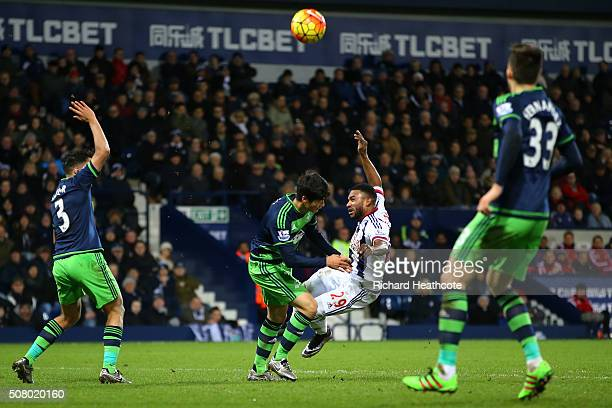 Stephane Sessegnon of West Bromwich Albion and Ki SungYeung of Swansea City collide during the Barclays Premier League match between West Bromwich...
