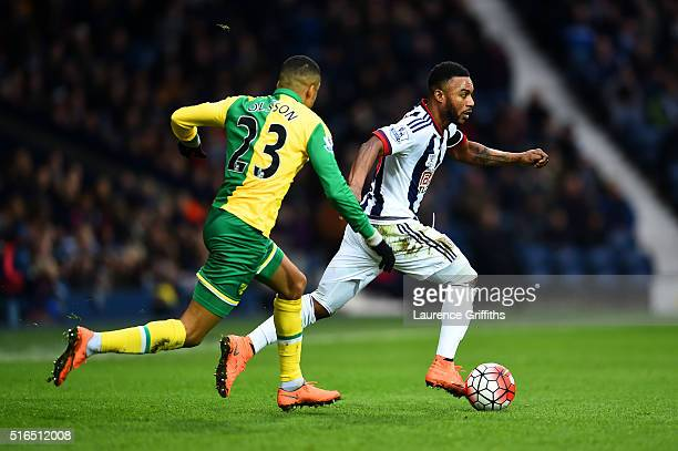 Stephane Sessegnon of West Bromwich Albion and Martin Olsson of Norwich City compete for the ball during the Barclays Premier League match between...