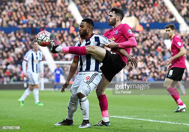 Stephane Sessegnon of West Bromwich Albion and Michael Smith of Peterborough United compete for the ball during the Emirates FA Cup Fourth Round...