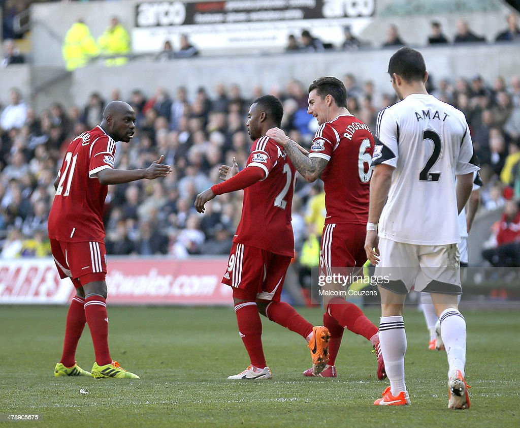 Stephane Sessegnon of West Bromwich Albion celebrates his goal with Youssouf Mulumbi (left) and Liam Ridgewell during the Barclays Premier League match between Swansea City and West Bromwich Albion at The Liberty Stadium on March 15, 2014 in Swansea, Wales.