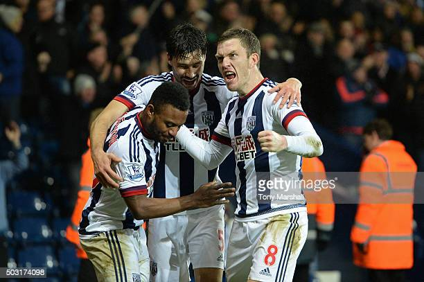 Stephane Sessegnon of West Bromwich Albion celebrates scoring his team's first goal with his team mates Claudio Yacob and Craig Gardner during the...