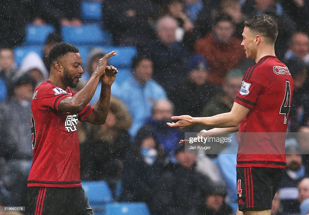 Stephane Sessegnon (L) of West Bromwich Albion celebrates scoring his team's first goal with his team mate <a gi-track='captionPersonalityLinkClicked' href=/galleries/search?phrase=James+Chester&family=editorial&specificpeople=4192570 ng-click='$event.stopPropagation()'>James Chester</a> (R) during the Barclays Premier League match between Manchester City and West Bromwich Albion at the Etihad Stadium on April 9, 2016 in Manchester, England.