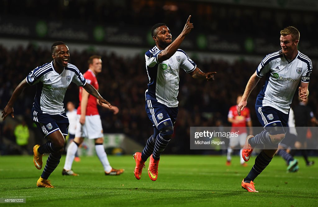 Stephane Sessegnon of West Bromwich Albion celebrates with Saido Berahino and Chris Brunt as he scores their first goal during the Barclays Premier...
