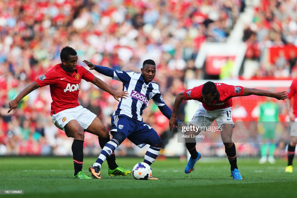 Stephane Sessegnon (C) of West Bromwich Albion holds off Anderson (L) and Nani (R) of Manchester United during the Barclays Premier League match between Manchester United and West Bromwich Albion at Old Trafford on September 28, 2013 in Manchester, England.