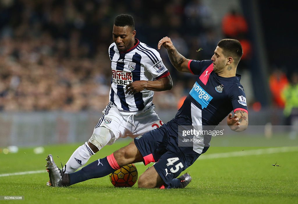 Stephane Sessegnon of West Bromwich Albion is tackled by Aleksandar Mitrovic of Newcastle United during the Barclays Premier League match between West Bromwich Albion and Newcastle United at The Hawthorns on December 28, 2015 in West Bromwich, England.