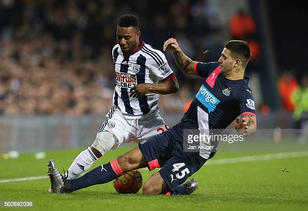 Stephane Sessegnon of West Bromwich Albion is tackled by Aleksandar Mitrovic of Newcastle United during the Barclays Premier League match between...