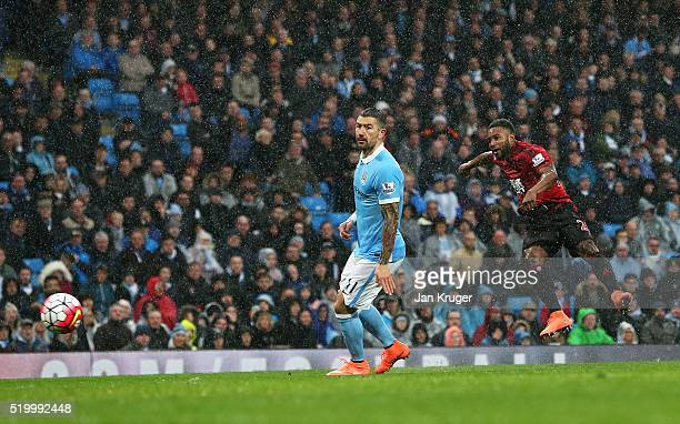 Stephane Sessegnon of West Bromwich Albion scores his team's first goal during the Barclays Premier League match between Manchester City and West...
