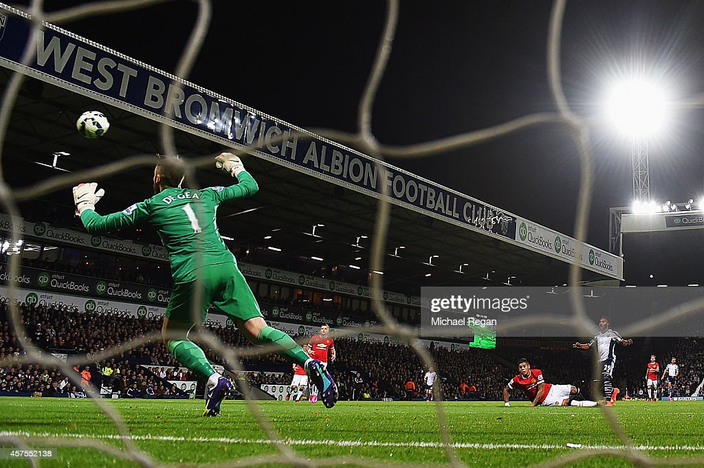 Stephane Sessegnon of West Bromwich Albion (R) shoots past goalkeeper David De Gea of Manchester United to score their first goal during the Barclays Premier League match between West Bromwich Albion and Manchester United at The Hawthorns on October 20, 2014 in West Bromwich, England.