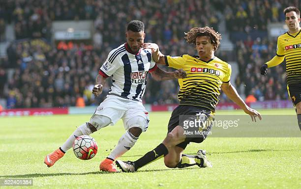 Stephane Sessegnon of West Bromwich Albion tussles for the ball with Nathan Ake of Watford during the Barclays Premier League match between West...