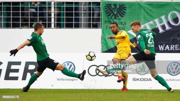 Stephane Tritz and Lion Schweers of Muenster challenges Saliou Sane of SonnenhofGrossaspach during the 3 Liga match between SC Preussen Muenster and...
