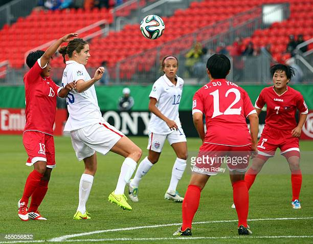 Stephanie Amack of the United States juggles the ball against Korea DPR during the FIFA U20 Women's World Cup Canada 2014 Quarter Final match between...