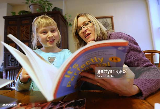 Stephanie Baptist and her 8 year daughter read a book called 'It's Perfectly Normal Changing Bodies Growing Up Sex and Sexual Health which is a...
