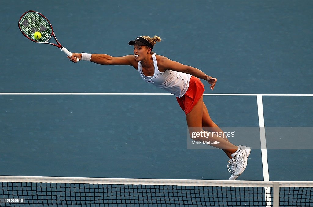 Stephanie Bengson of Australia plays a forehand volley in her qualifying singles match with Sacha Jones of Australia during day one of the Hobart International at Domain Tennis Centre on January 4, 2013 in Hobart, Australia.