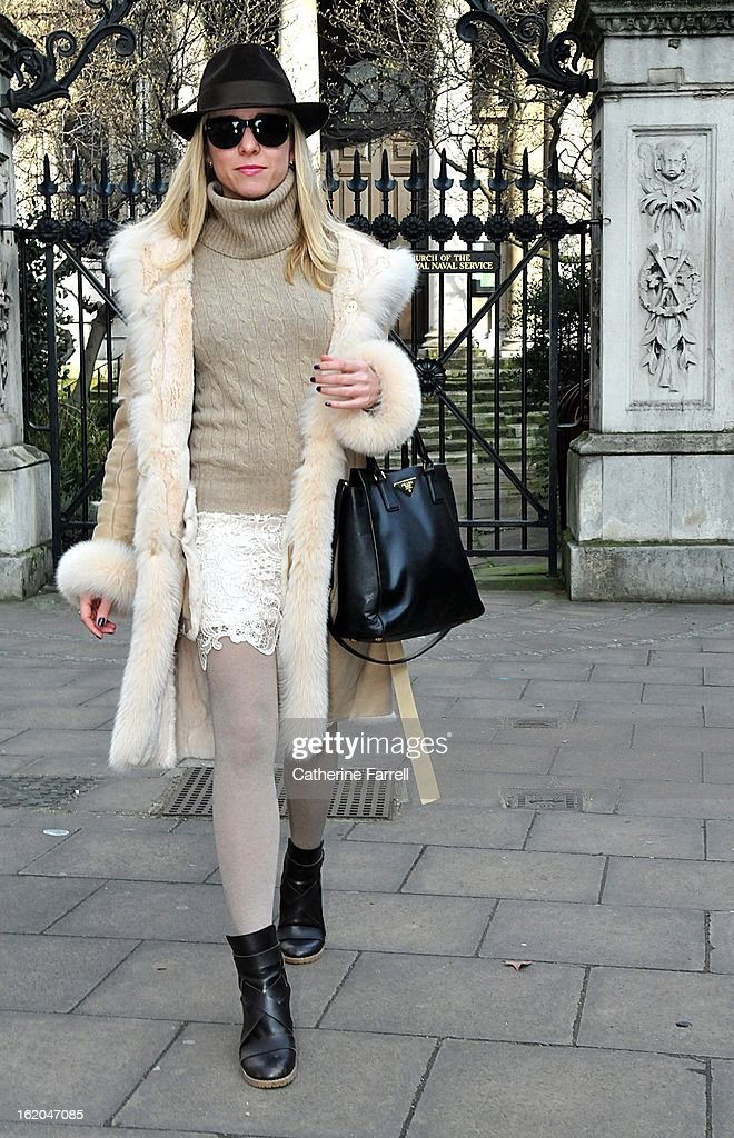 Stephanie Bruckner, Financial trader from New York wearing monochromatic shades of camel and cream, bespoke sheeps skin coat, Ralph Lauren sweater, Top Shop skirt, tights from Florence airport, hat by La Cerise sur la Chapeau, Paris, Chloe boots, and Chanel sunglasses, earrings from NY, at London Fashion Week Fall/Winter 2013/14 on February 18, 2013 in London, England.