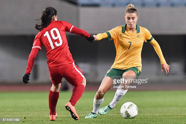 Stephanie Catley of Australia and Tan Ruyin of China compete for the ball during the AFC Women's Olympic Final Qualification Round match between...
