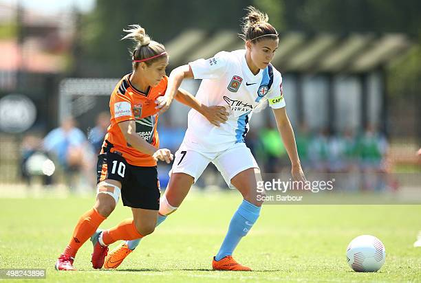 Stephanie Catley of City and KatrinaLee Gorry of the Roar compete for the ball during the round six WLeague match between Melbourne City and the...