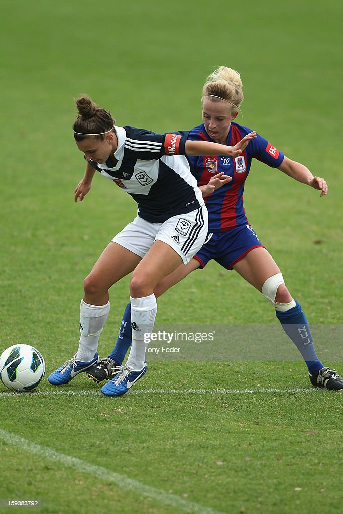 Stephanie Catley of the Melbourne Victory and Hannah Brewer of the Newcastle Jets contest the ball during the round 12 W-League match between the Newcastle Jets and the Melbourne Victory at Wanderers Oval on January 13, 2013 in Newcastle, Australia.