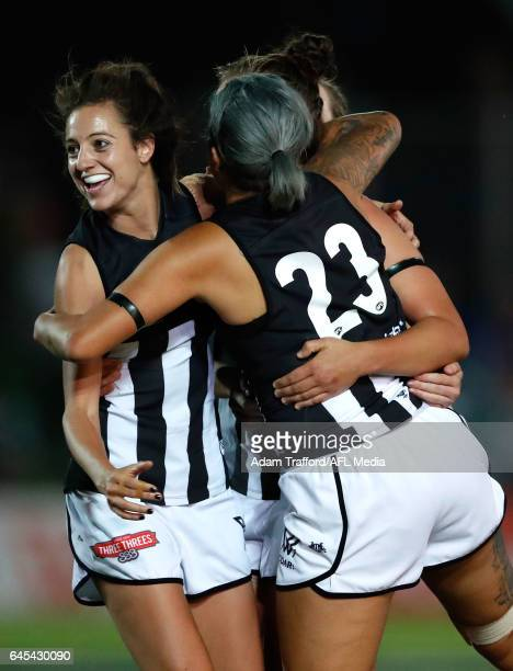 Stephanie Chiocci of the Magpies celebrates with Moana Hope and Jasmine Garner of the Magpies during the 2017 AFLW Round 04 match between the Western...