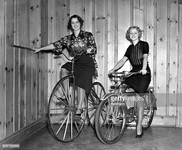 Stephanie Cienke on an 1868 bicycle and Violet Cienke on a modern bicycle demonstrate the difference in the bikes of the two eras This picture was...
