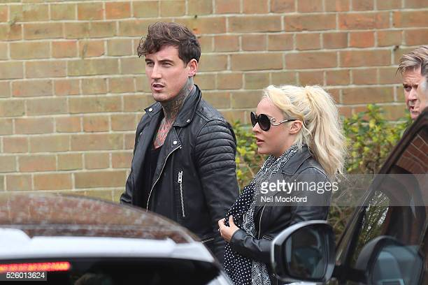 Stephanie Davis and Jeremy McConnell arriving at the funeral of David Gest at Golders Green Crematorium on April 29 2016 in London England