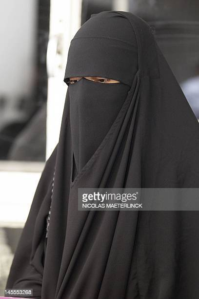 Stephanie Djato a woman who was arrested yesterday for wearing a niqab and assaulting a police officer in SintJansMolenbeek attends a press...