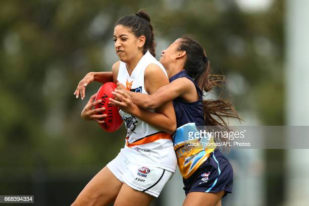 Stephanie Elias of the Calder Cannons is tackled by Tia Needs of the Bendigo Pioneers during the TAC Cup Girls round five match between the Calder...