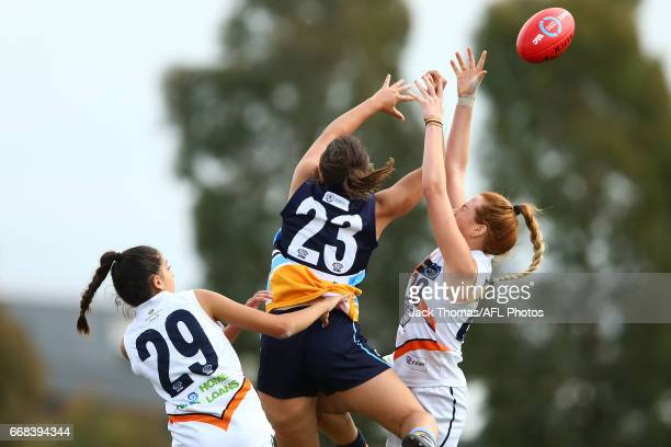 Stephanie Elias of the Calder Cannons Taylor Bellesini of the Bendigo Pioneers and Rose Love of the Calder Cannons compete for the ball during to the...