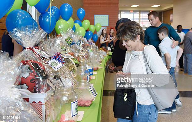 Stephanie Ellington participates in a raffle to benefit Bob's Buddies an organization that raises money for research into pediatric brain tumors on...