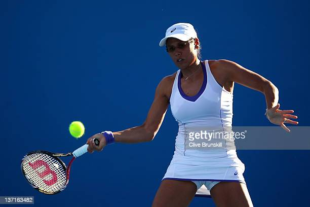Stephanie Foretz Gacon of France plays a forehand in her first round match against Elena Baltacha of Great Britain during day one of the 2012...