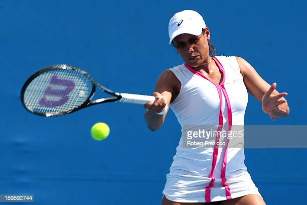 Stephanie Foretz Gacon of France plays a forehand in their first round doubles match with Akgul Amanmuradova of Uzbekistan against Ekaterina Makarova...