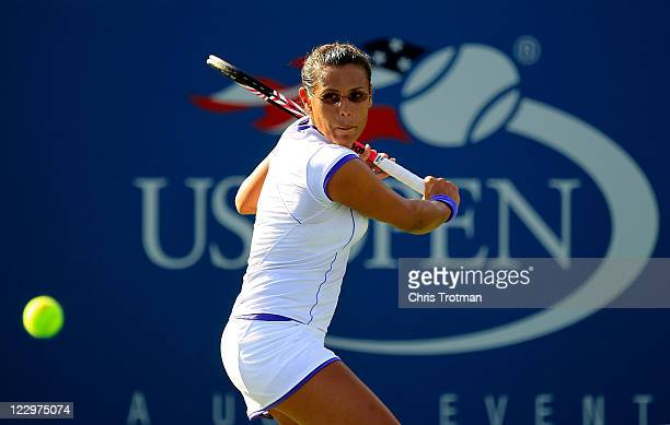Stephanie Foretz Gacon of France returns the ball against Vera Zvonareva of Russia during Day One of the 2011 US Open at the USTA Billie Jean King...