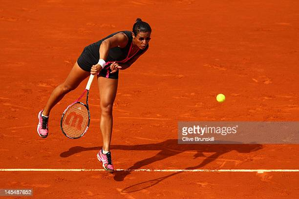 Stephanie Foretz Gacon of France serves in her women's singles second round match against Na Li of China during day 5 of the French Open at Roland...