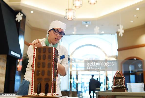Stephanie Gaines a student at Johnson Wales take part in a gingerbread building competition to be displayed in the lobby of The Sheraton Denver...