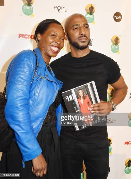Stephanie Guittonneau from FDF magazine and rap artist/actor Stomy Bugsy attend the 'Afro' Rokhaya Diallo and photographer Brigitte Sombie Exhibition...