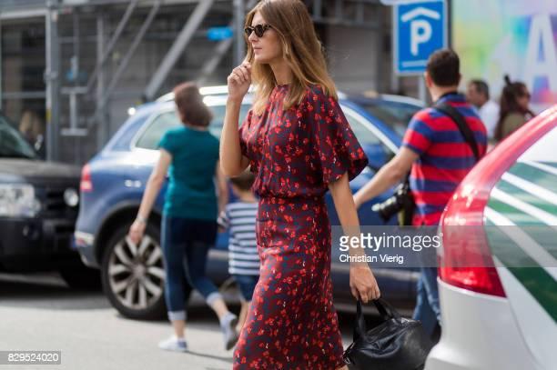 Stephanie Gundelach wearing a red dress with floral print outside Baum Und Pferdgarten on August 10 2017 in Copenhagen Denmark