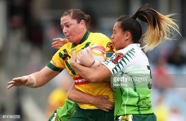 Stephanie Hancock of Australia is tackled during the 2017 Women's Rugby League World Cup match between Australia and Cook Islands at Southern Cross...