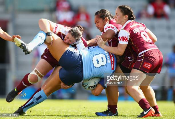 Stephanie Hancock of Queensland tackles Ruan Sims of NSW during the Women's Interstate Challenge match between New South Wales and Queensland at WIN...