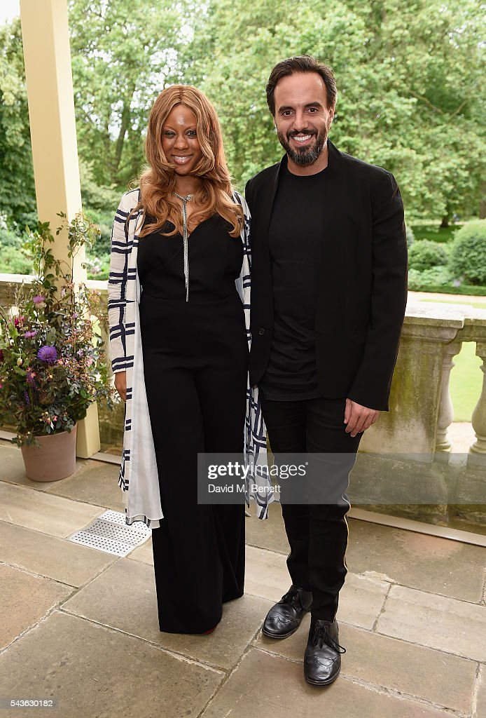 Stephanie Horton and Jose Neves attend the Creatures of the Wind Resort 2017 collection and runway show presented by Farfetch at Spencer House on June 29, 2016 in London, England.