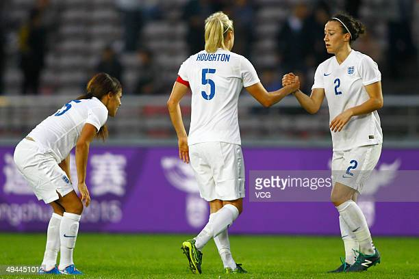 Stephanie Houghton and Lucy Bronze of England celebrate in the match between England and Australia during the 2015 Yongchuan Women's Football...