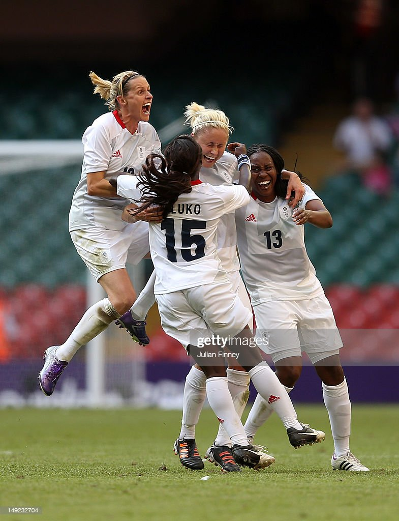 Stephanie Houghton of Great Britain is congratulted by team mates Kelly Smith of Great Britain, Eniola Aluko of Great Britain and Ifeoma Dieke of Great Britain after scoring a free kick during the Women's Football first round Group E Match of the London 2012 Olympic Games between Great Britain and New Zealand at Millennium Stadium on July 25, 2012 in Cardiff, Wales.