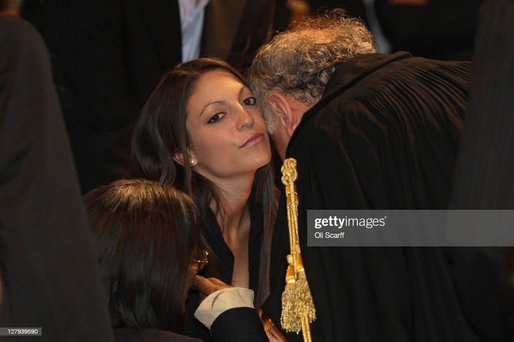 Stephanie Kercher, the sister of murdered student Meredith Kercher, is greeted in Perugia's Court of Appeal by prosecutor Giuliano Mignini before learning that Amanda Knox won her appeal against her murder conviction on October 3, 2011 in Perugia, Italy. American student Amanda Knox and her Italian ex-boyfriend Raffaele Sollecito have won their appeal against their conviction in 2009 of killing their British roommate Meredith Kercher in Perugia, Italy in 2007. The pair had served nearly four years in jail after initially being sentenced to 26 and 25 years respectively.