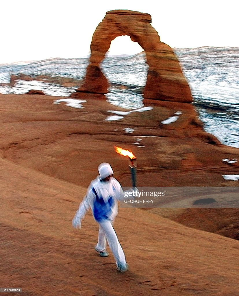 stephanie laree spann runs the olympic torch in th pictures stephanie laree spann runs the olympic torch in the bowl of delicate arch in arches national