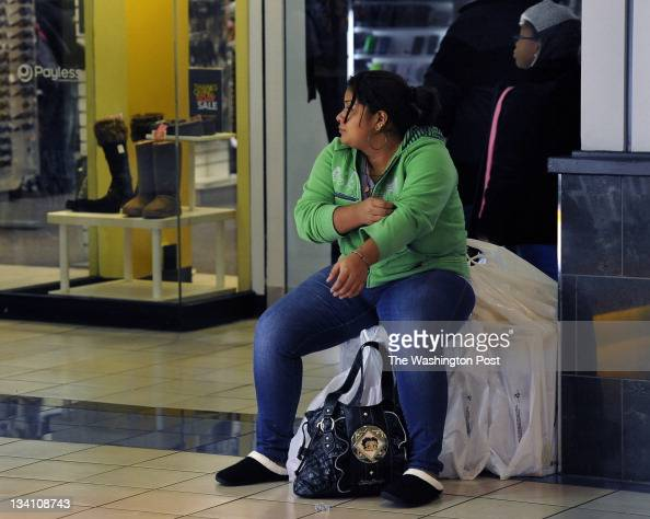 Stephanie Larios needed a break from shopping so she just used her purchases at a chair She's from Hyattsville Maryland Black Friday began at...