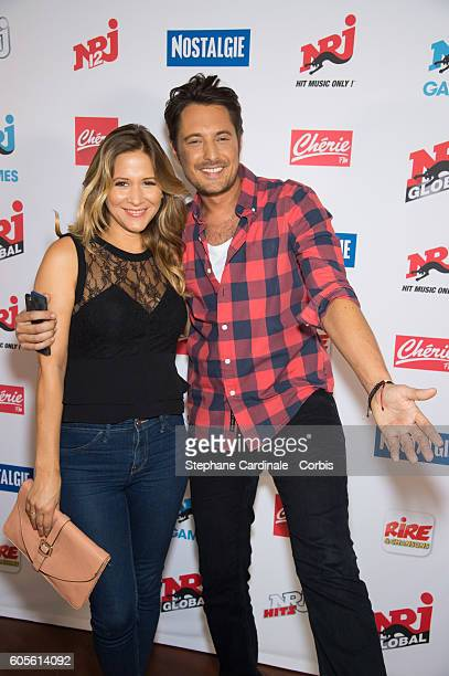 Stephanie Loire and Vincent Cerutti pose at the Photocall of NRJ Group at Musee du Quai Branly on September 14 2016 in Paris France